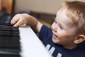happy boy at the piano