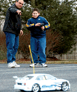 dad and son with rc car