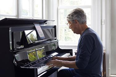 senior man at the piano