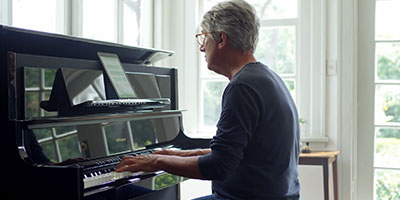 older man playing the piano