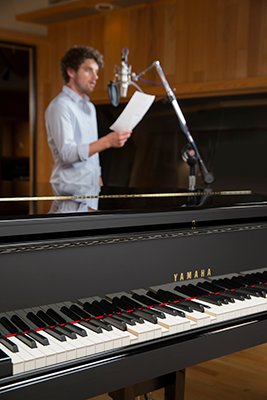 student singing with yamaha disklavier
