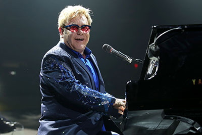elton john playing yamaha piano